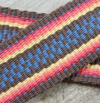 guitar strap, handwoven on an inkle loom, brown, blue and shades of coral and yellow