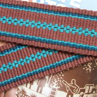 guitar strap, handwoven in brown and turquoise pattern